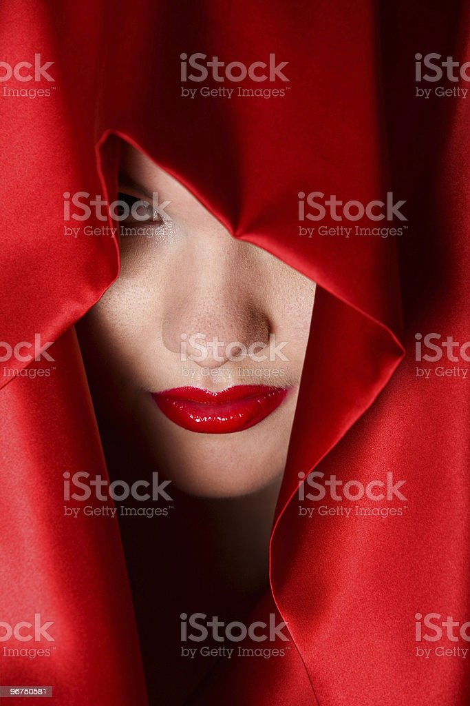 Attractive young woman in red hood stock photo