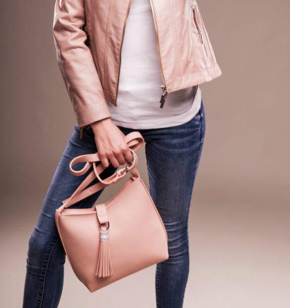 Attractive Young Woman in Spring Fashion Leather Jacket stock photo