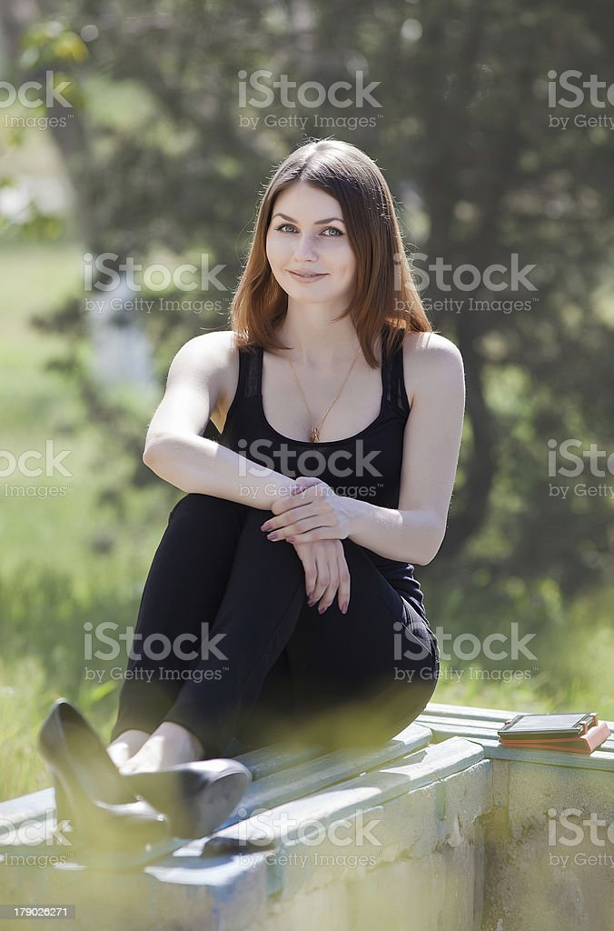 Attractive young woman in the park royalty-free stock photo
