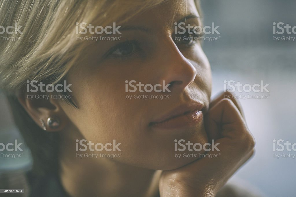 attractive young woman in thoughts royalty-free stock photo