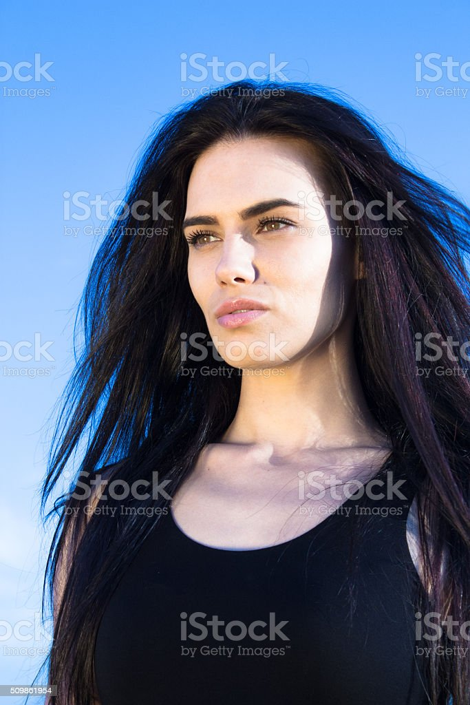 Attractive young woman looking away stock photo