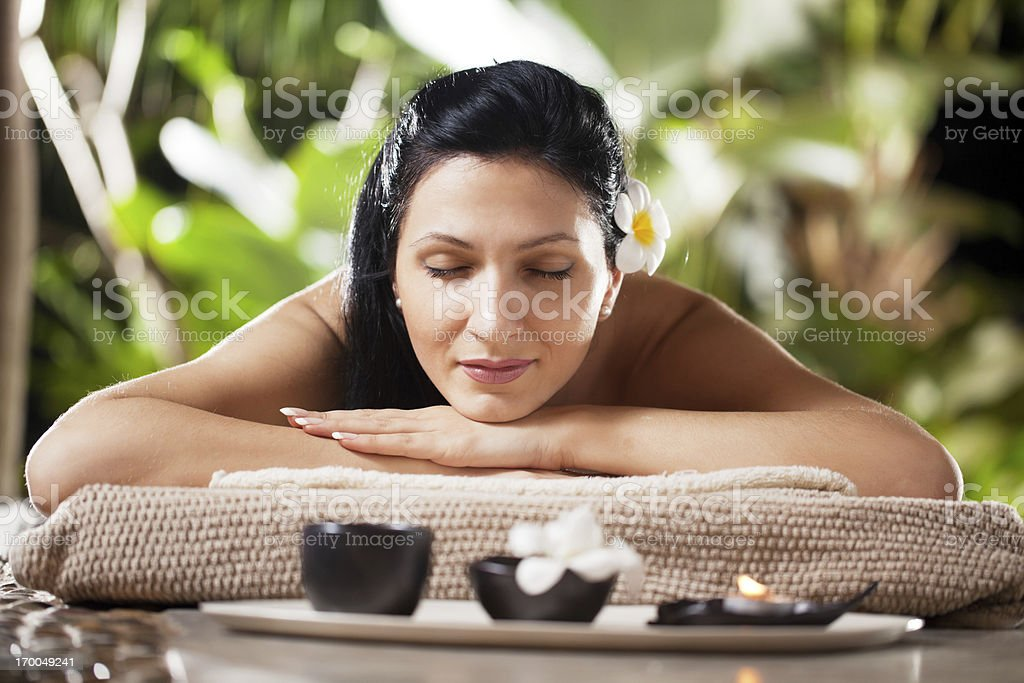 Attractive young woman lying and relaxing at spa center. royalty-free stock photo