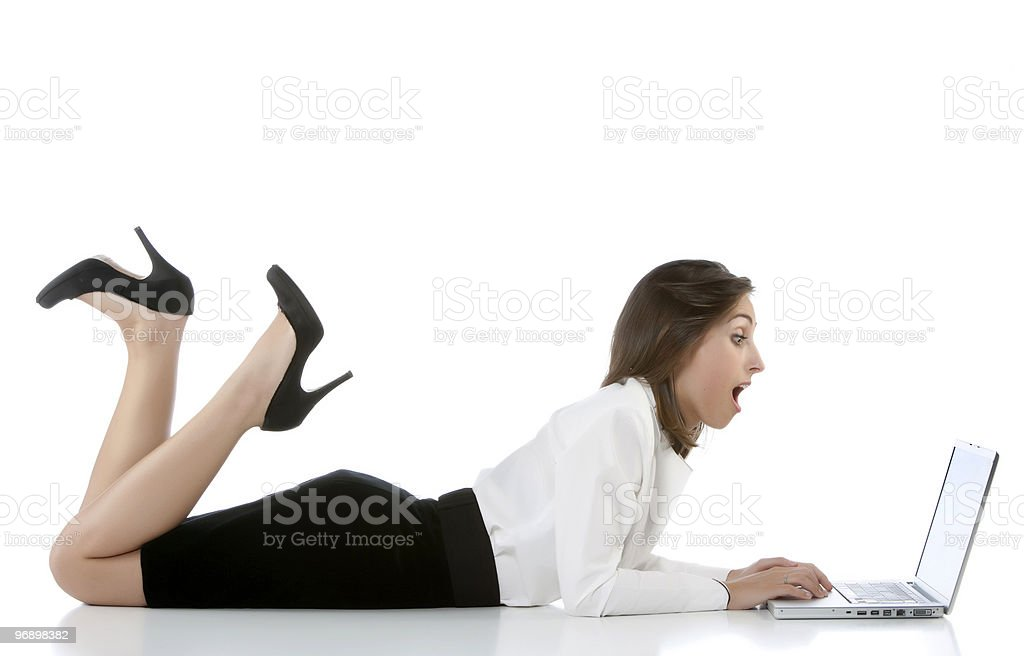 Attractive young woman lying on the desk royalty-free stock photo