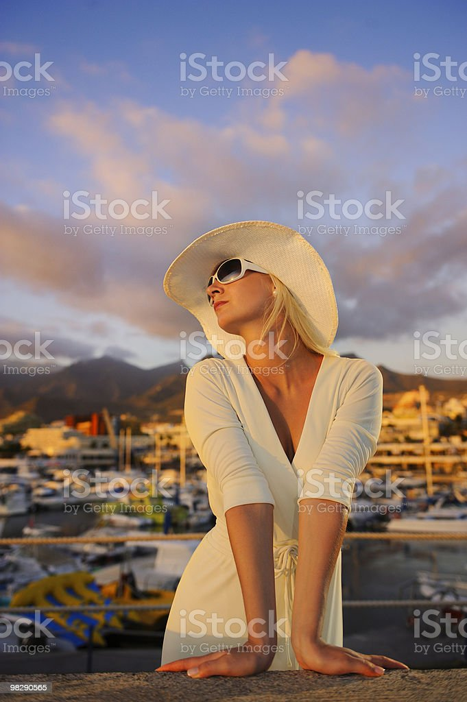 Attractive young woman near the yachts royalty-free stock photo