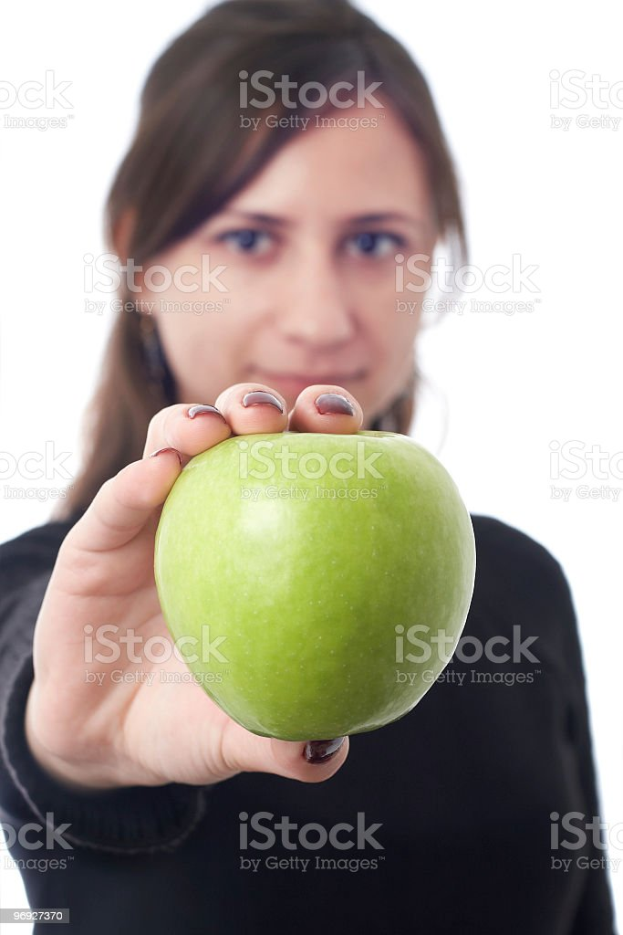attractive young woman offers up a shiny green apple royalty-free stock photo