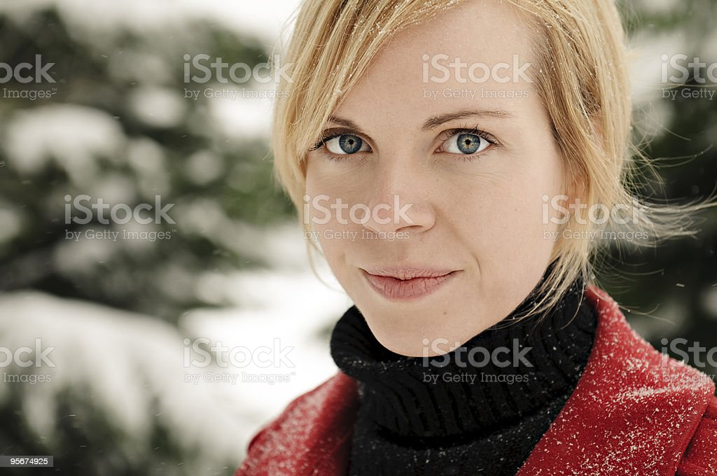 Attractive Young Woman on a Snowy Day royalty-free stock photo