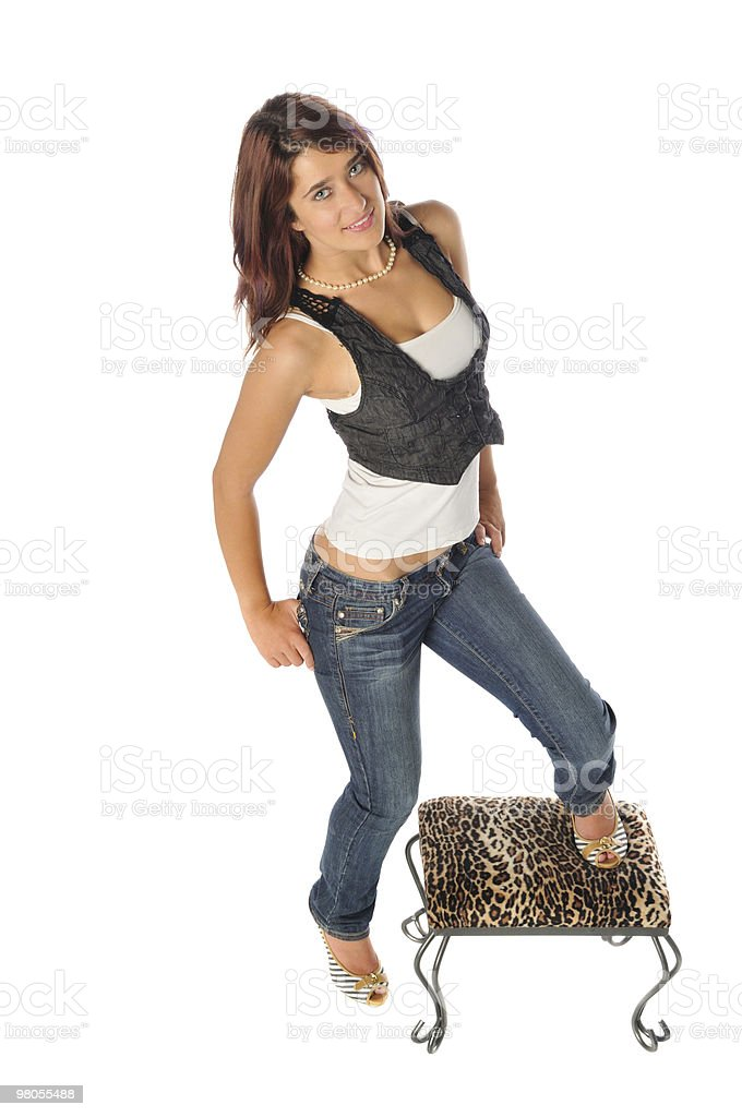 attractive young woman on a stool  royalty-free stock photo