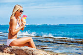 istock Attractive Young Woman on Beach with Tropical Refreshment 174870023