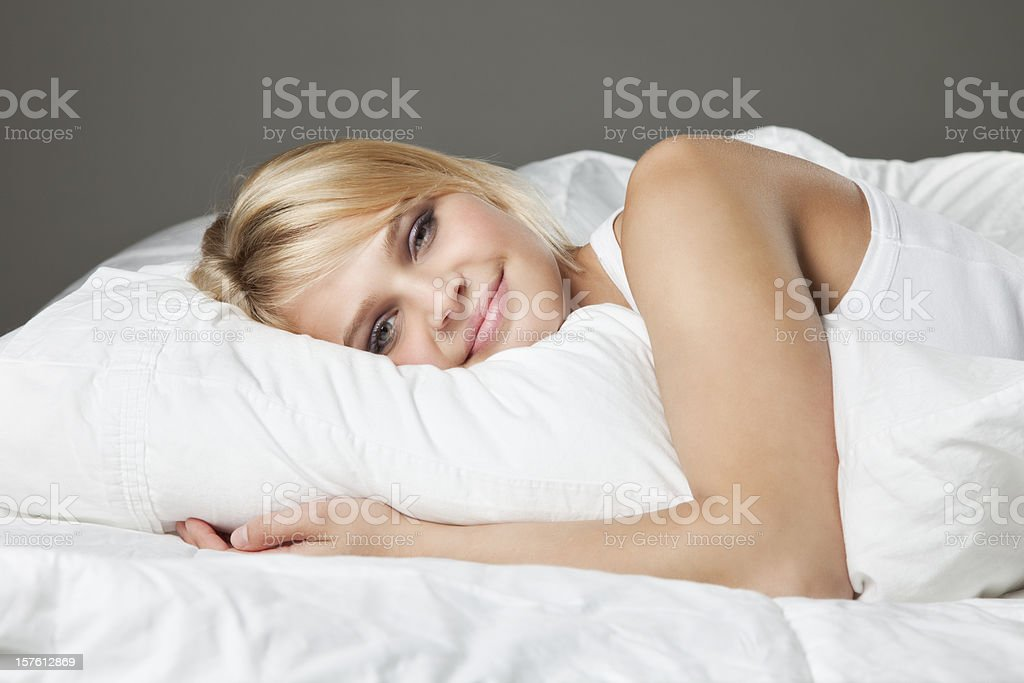 Attractive Young Woman on Bed royalty-free stock photo