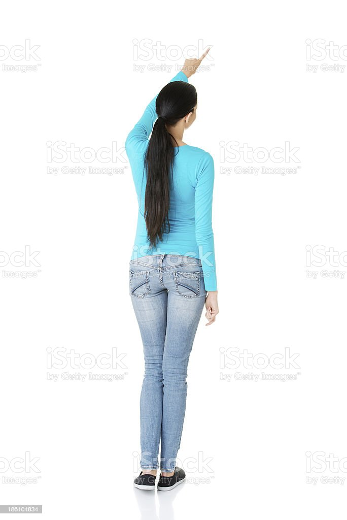 Attractive young woman pointing on copy space. royalty-free stock photo