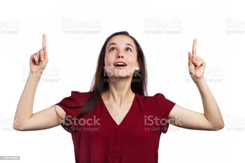 Attractive young woman pointing up photo libre de droits