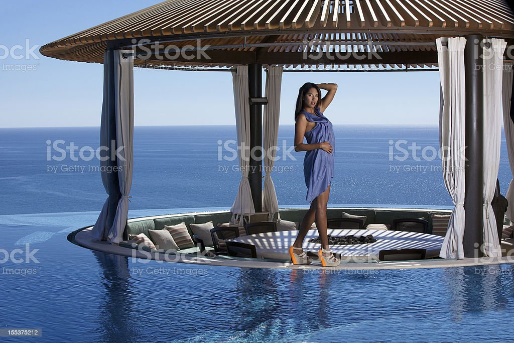 Attractive young woman posing in a Gazebo royalty-free stock photo