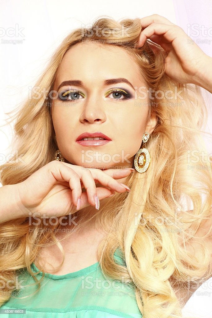 Attractive young woman posing on white background, close-up royalty-free stock photo