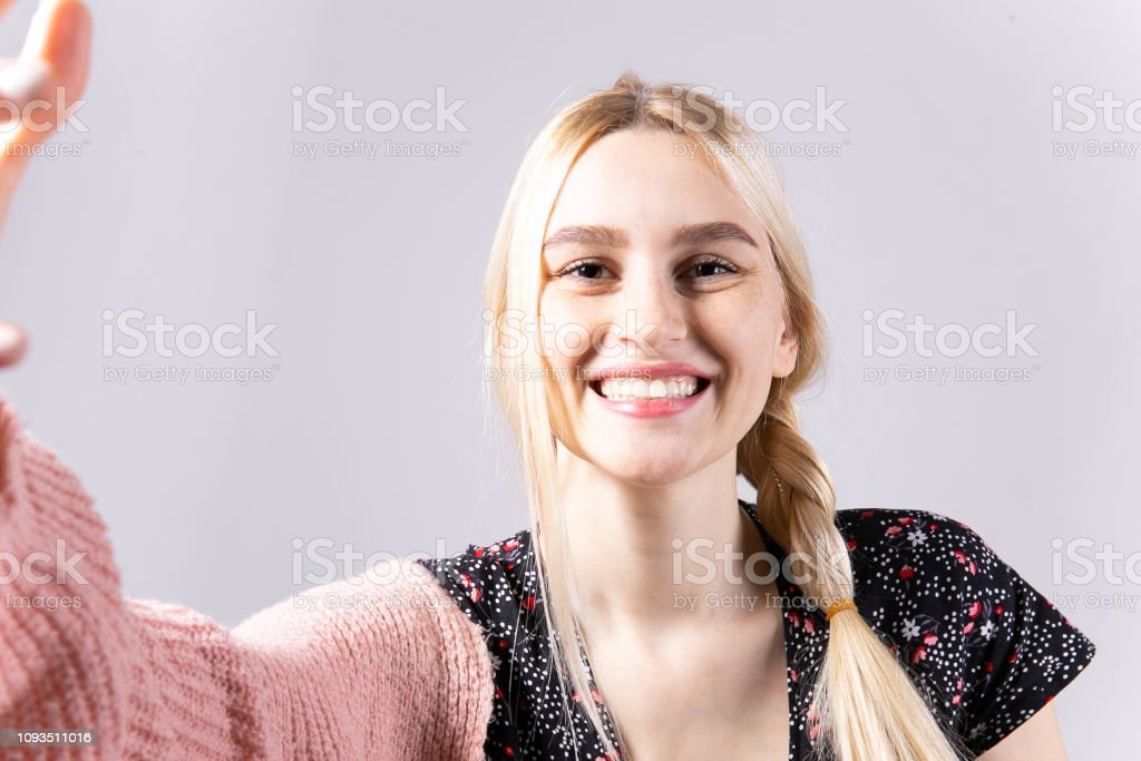 Attractive young woman posing over grey background. stock photo