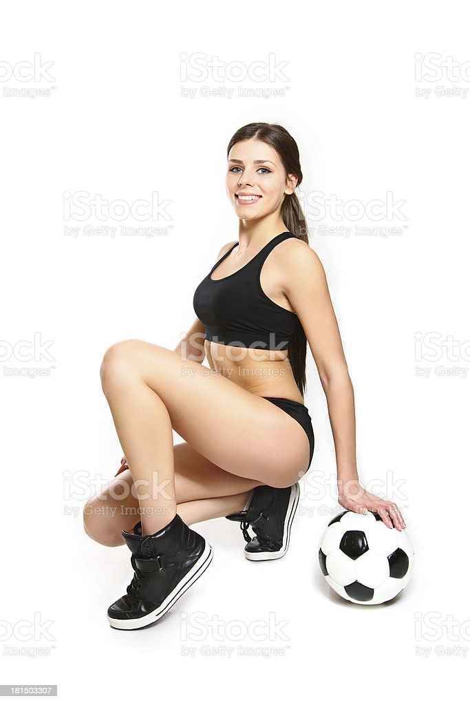 Attractive young woman posing with soccer ball on white background royalty-free stock photo