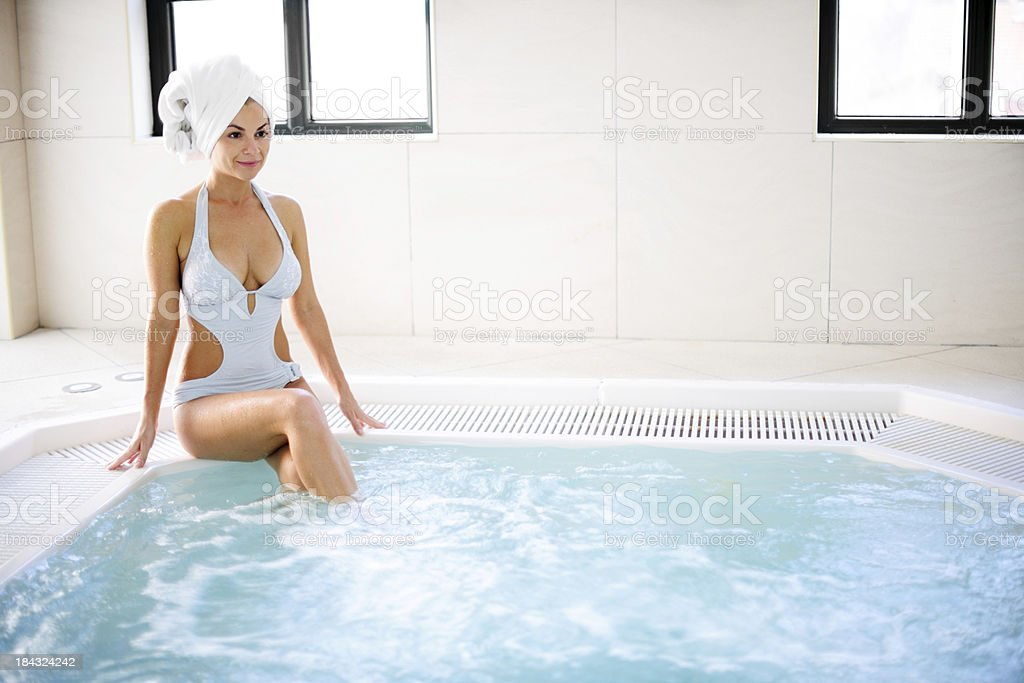 Attractive young woman relaxing herself in the Jacuzzi. royalty-free stock photo