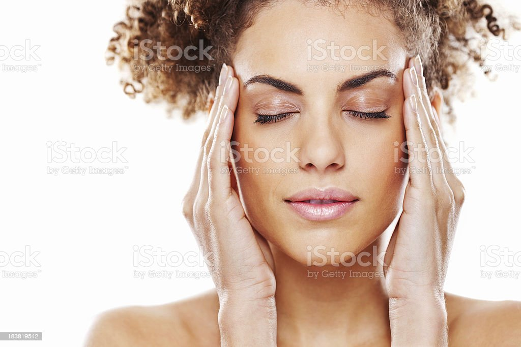 Attractive Young Woman Rubbing Her Temples royalty-free stock photo