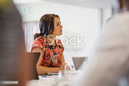 Confident businesswoman listening, success, professional, thoughtful