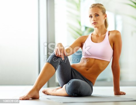 istock Attractive young woman sitting in sports wear 108328105