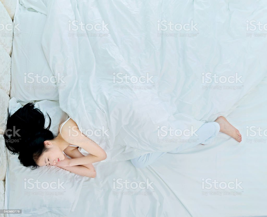 Attractive young woman sleeping stock photo