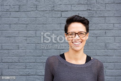 istock Attractive young woman smiling with glasses 510397772