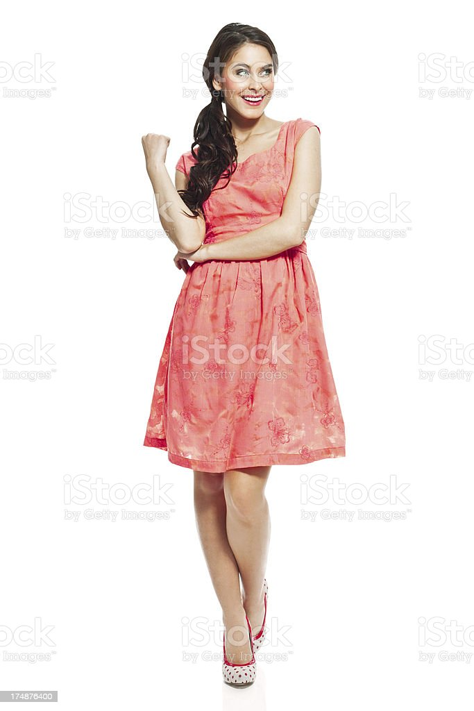 Attractive young woman, Studio Portrait Full lenght portrait of attractive young woman wearing dress and high heels. Studio shot on a white background. 20-24 Years Stock Photo