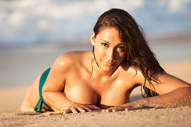 Attractive Young Woman Sunbathing on Hawaiian Beach stock photo