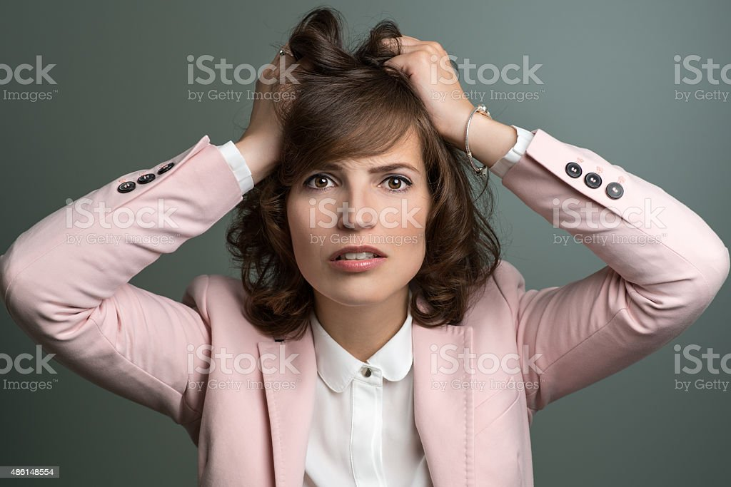Attractive young woman tearing at her hair stock photo