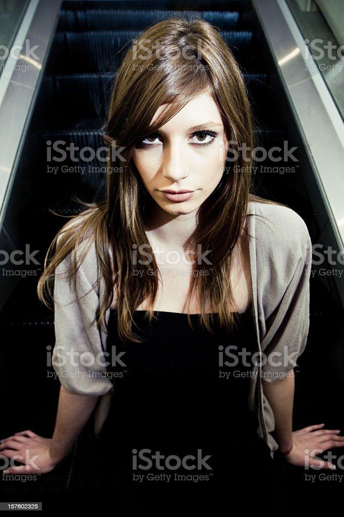 Attractive Young Woman Urban Escalator Portrait royalty-free stock photo