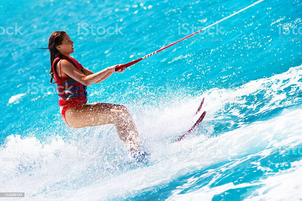 Attractive young woman water skiing stock photo