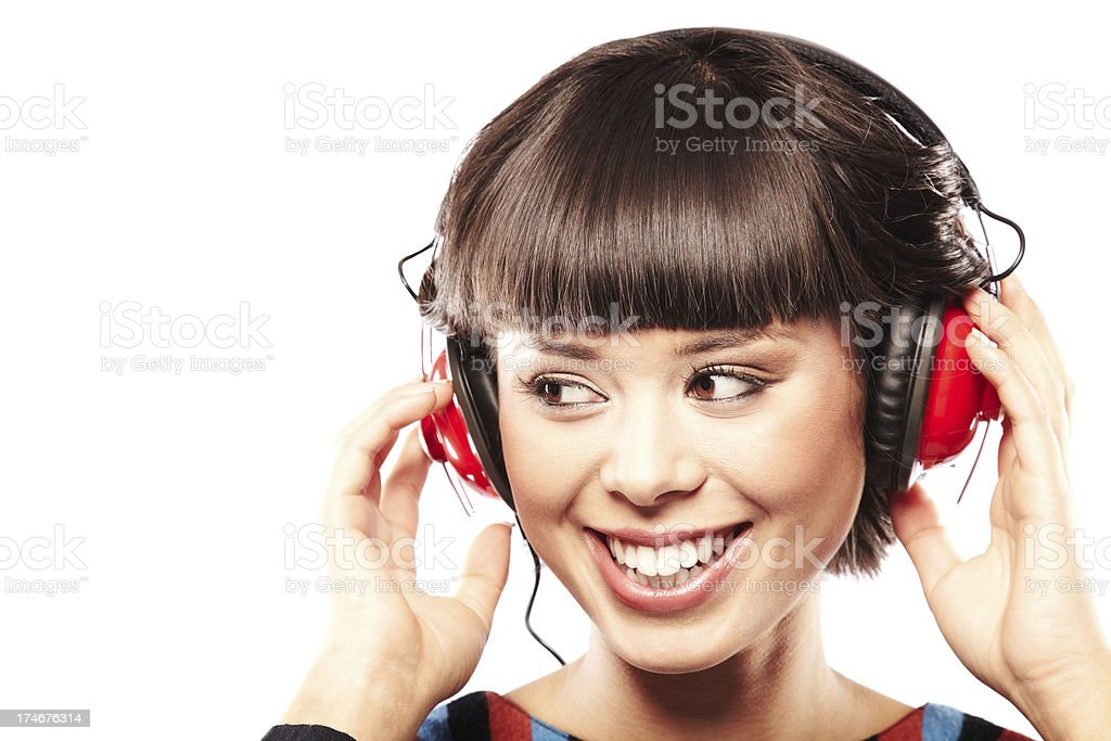 Attractive Young Woman wearing Headphones Listening to Music royalty-free stock photo