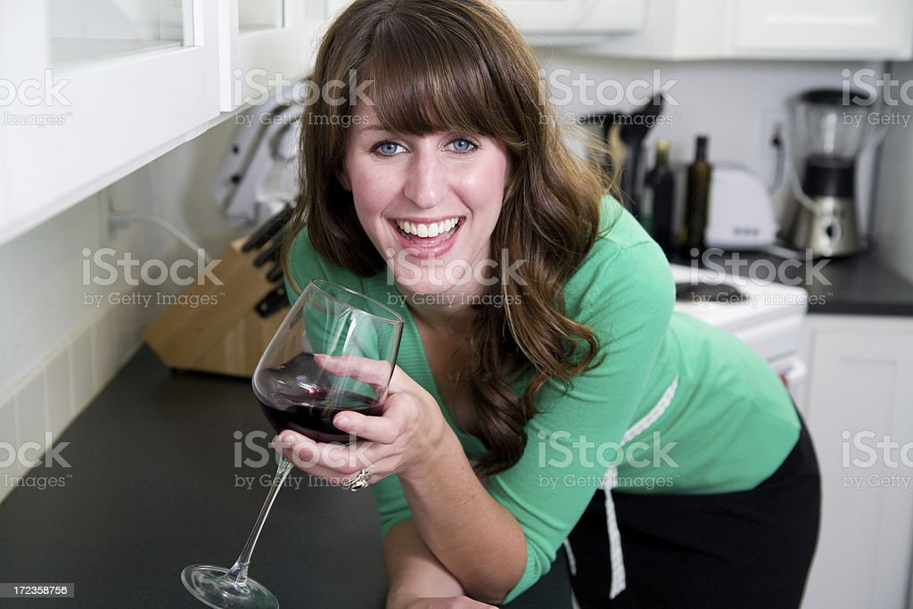 attractive young woman with a glass of wine royalty-free stock photo