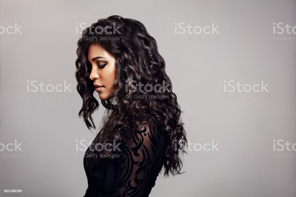 Attractive young woman with curly hair stock photo