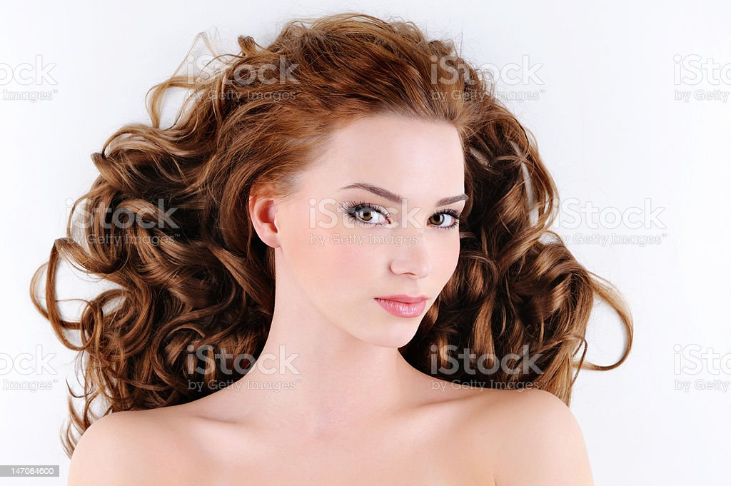attractive young woman with curly hairs stock photo