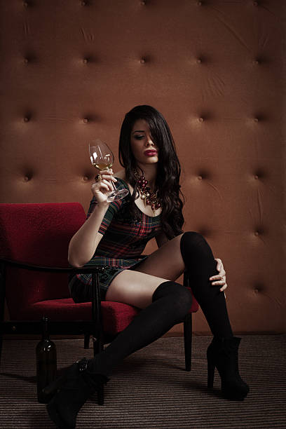 Attractive young woman with glass of wine