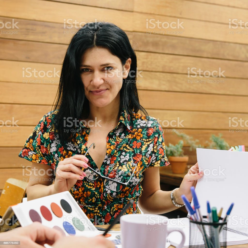 Attractive young woman with glasses working in the office royalty-free stock photo