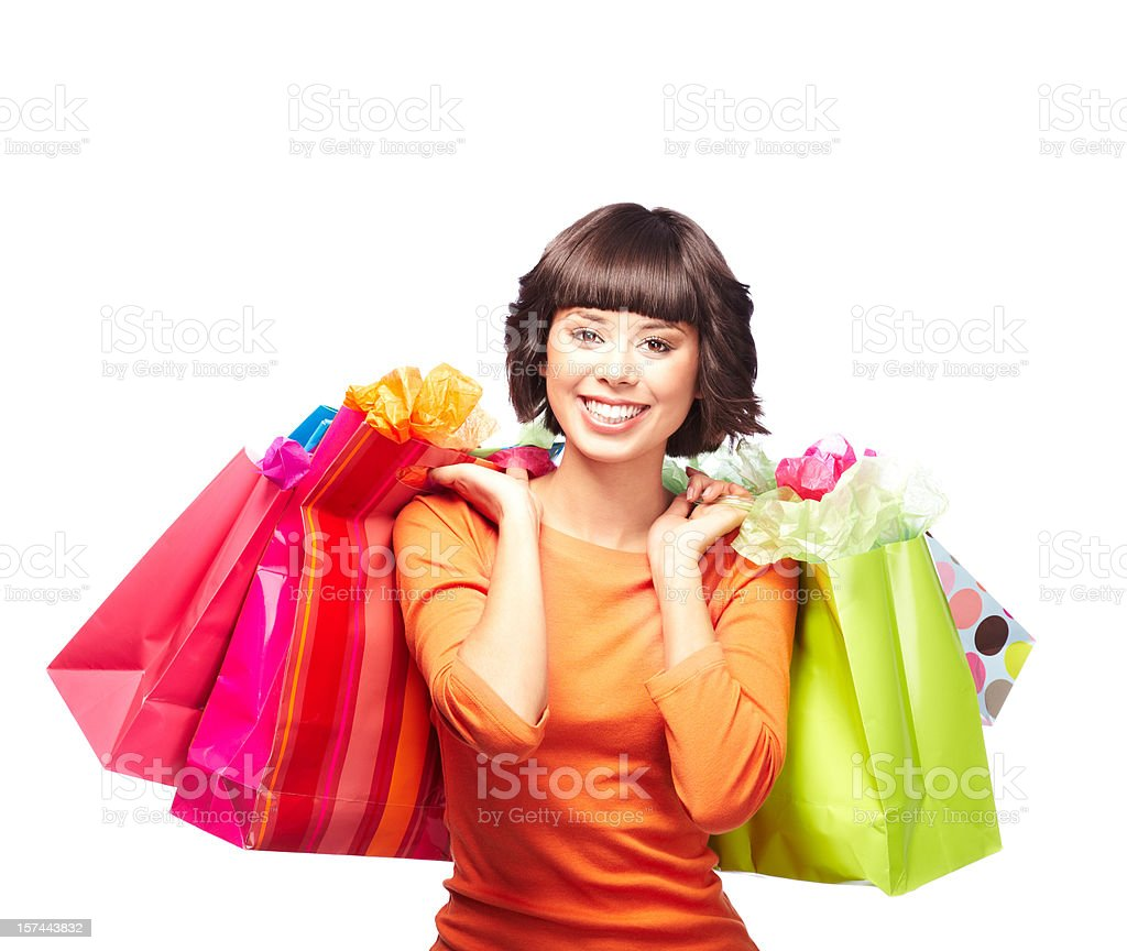 Attractive Young Woman With Hands Full of Shopping Bags royalty-free stock photo
