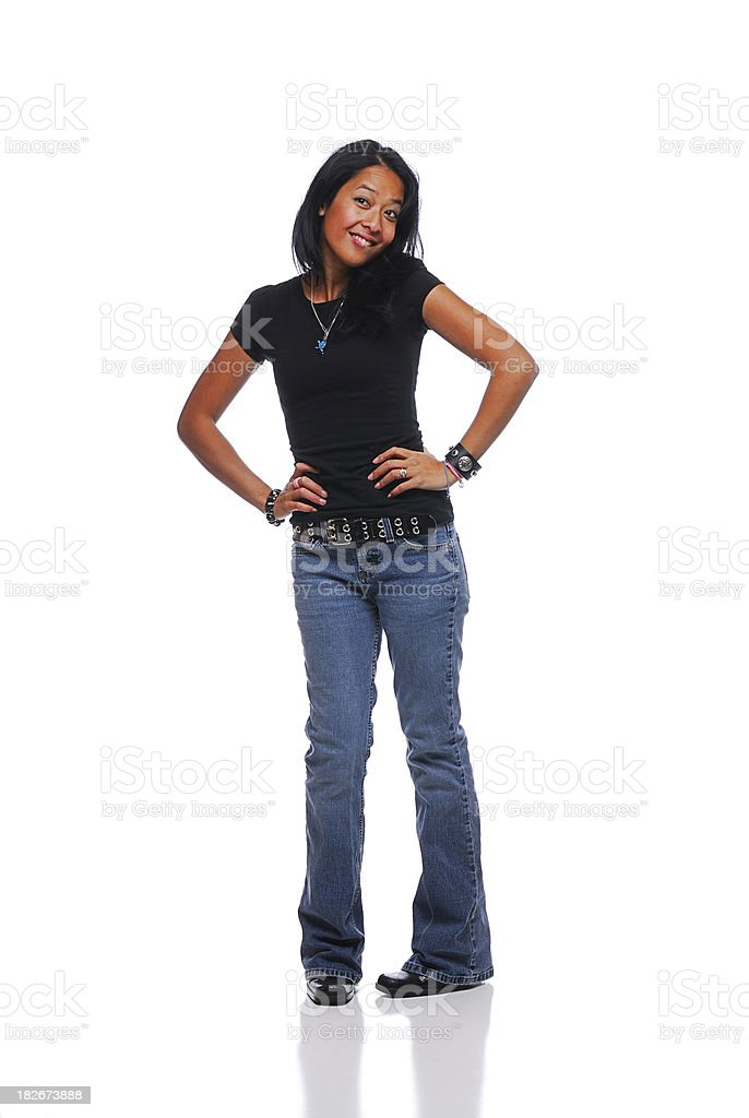 Attractive young woman with hands on hips against white background royalty-free stock photo