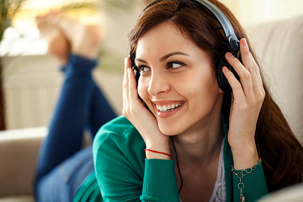 attractive young woman with headphones listens music on smartpho - free images for downloads stock photos and pictures