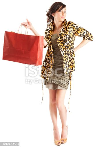 istock Attractive Young Woman with Red Shopping Bag 186829273