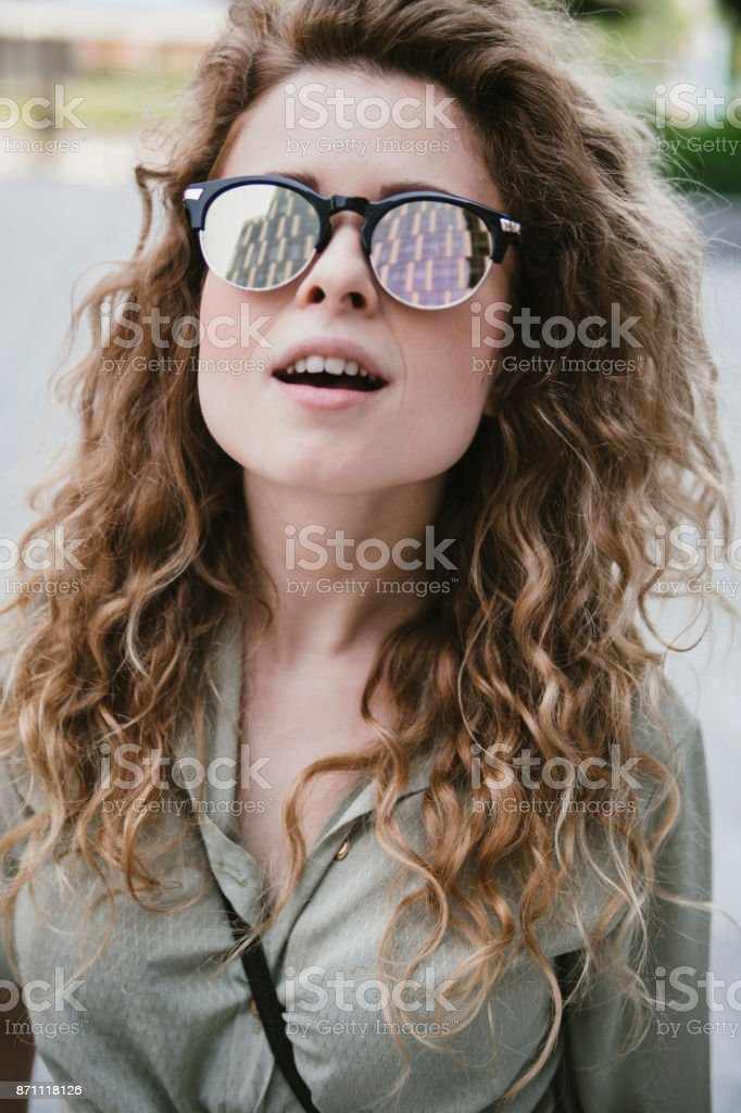 attractive young woman with reflective sunglasses - foto stock