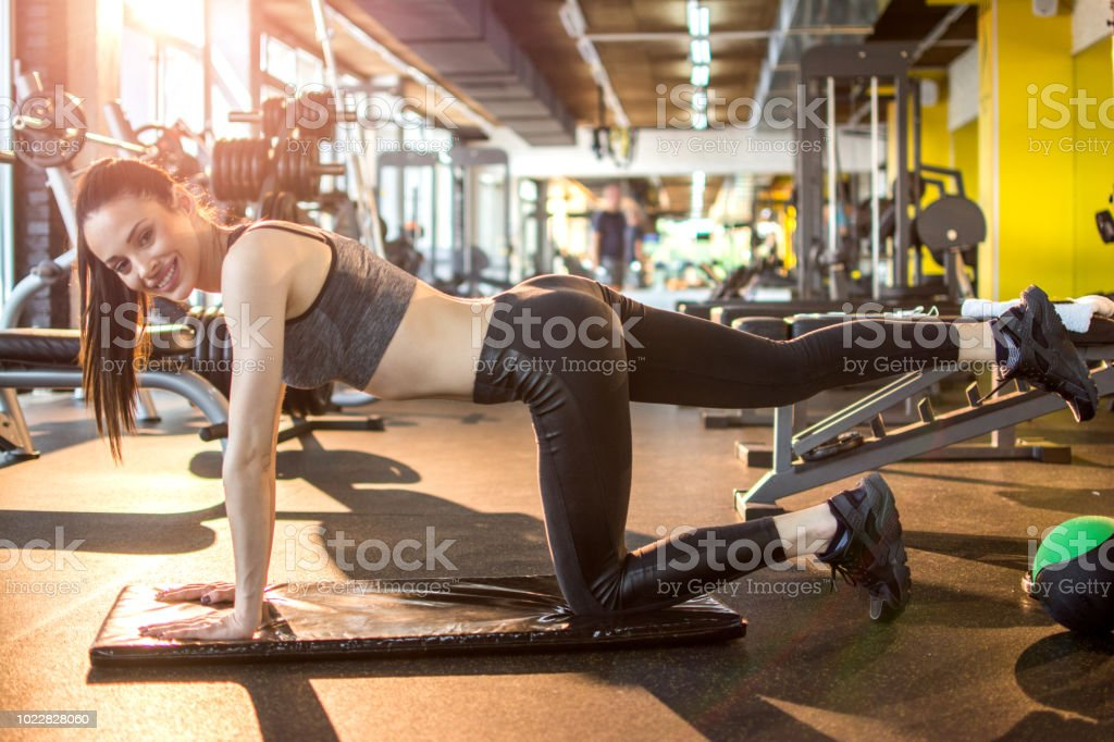 Attractive young woman working out at gym stock photo