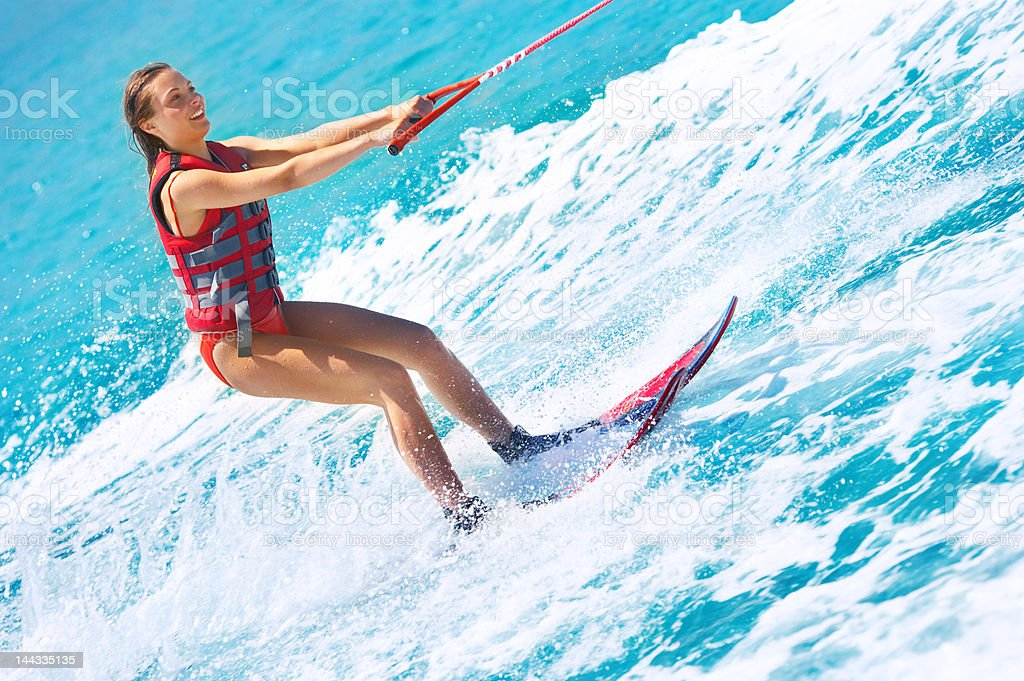Attractive young women water skiing stock photo