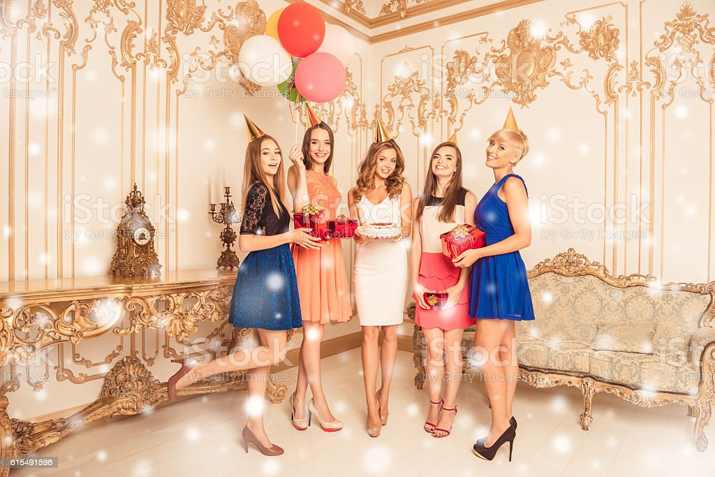 Cтоковое фото Attractive young women with cake having christmas party