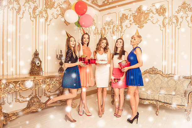 Attractive young women with cake having christmas party – zdjęcie