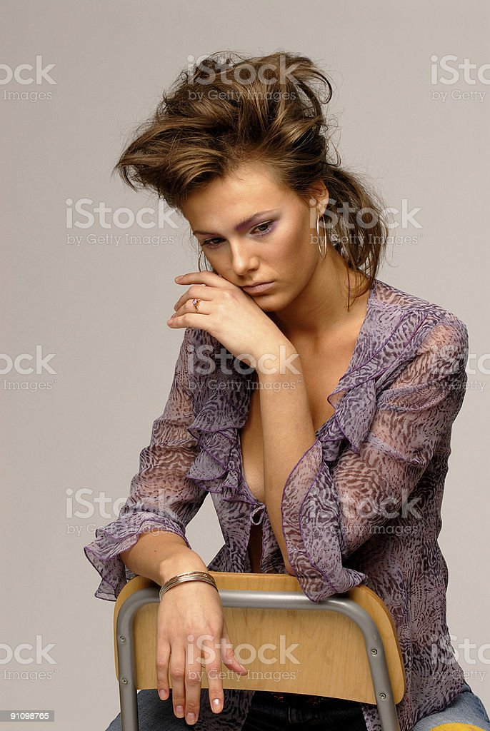 Attractive your woman sitting hand to her cheek royalty-free stock photo