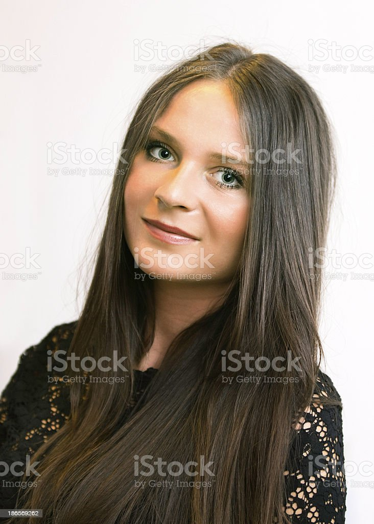 Attraktiv young woman with long brown hair portrait stock photo