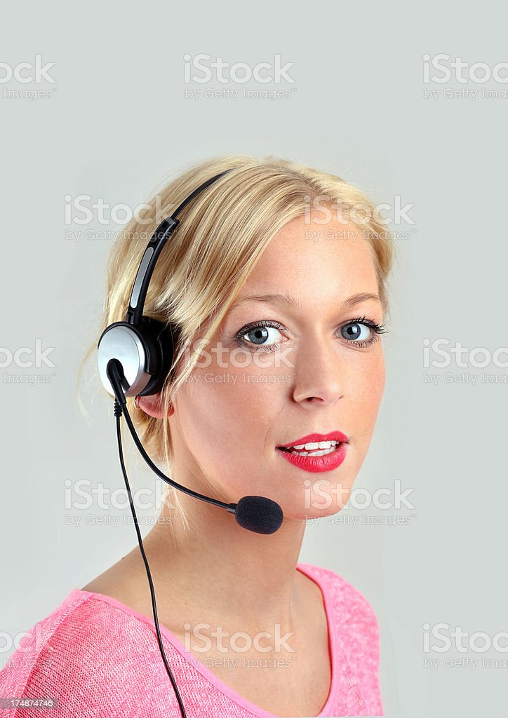 attraktive blond female call center agent stock photo