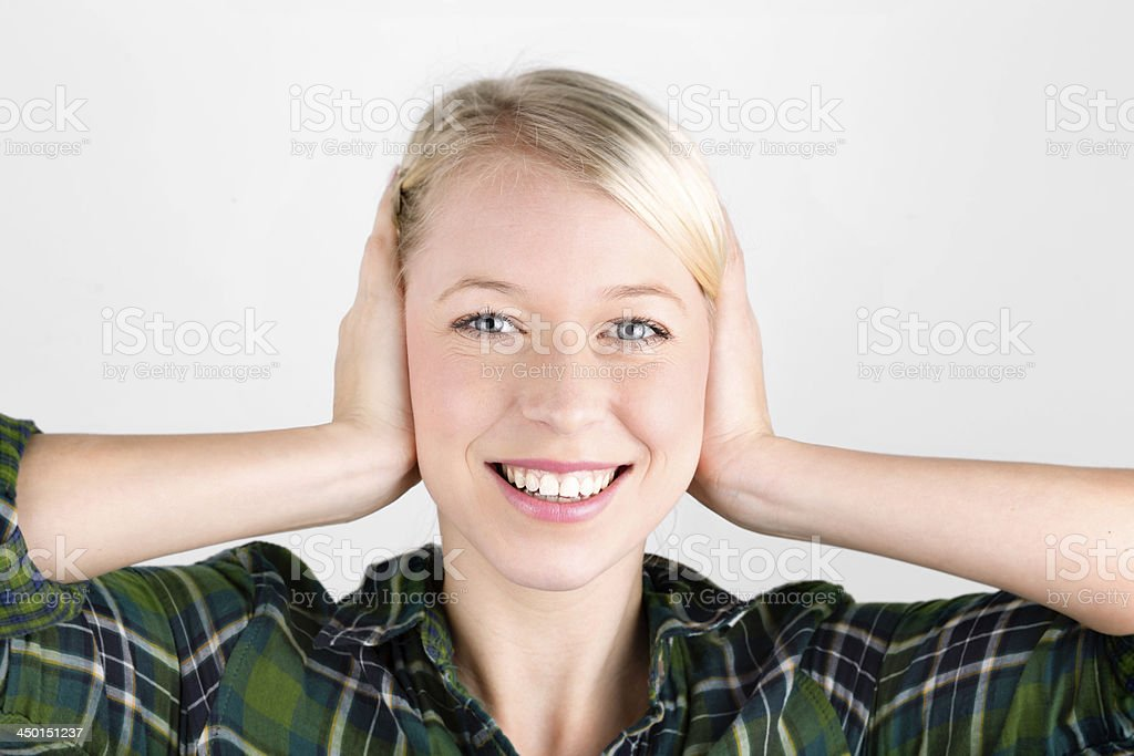 attraktive young blond woman plugs her ears stock photo