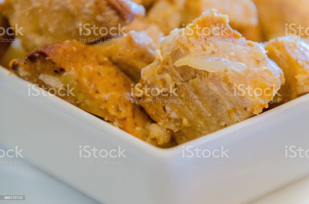 Atun encebollado, cubes of tuna fish stew with onions stock photo